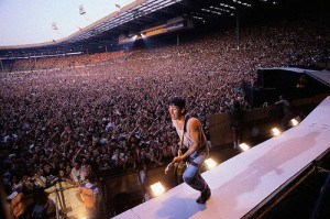 ca. 1985, Brent, London, England, UK --- Bruce Springsteen plays before an enormous crowd at Wembley Stadium. --- Image by © Neal Preston/CORBIS