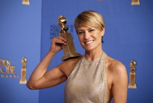 "Actress Robin Wright poses with the award for Best Actress in a TV Series, Drama for her role in ""House of Cards,"" backstage at the 71st annual Golden Globe Awards in Beverly Hills, California January 12, 2014. REUTERS/Lucy Nicholson (UNITED STATES - Tags: ENTERTAINMENT TPX IMAGES OF THE DAY) (GOLDENGLOBES-BACKSTAGE)"
