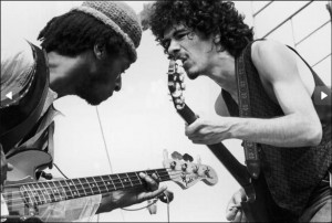 Carlos-Santana-right-and-bassist-David-Brown-perform-with-the-group-Santana-at-the-Woodstock-Music-Festival-in-Bethel-New-York