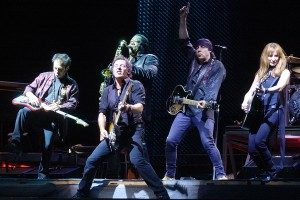 Bruce Springsteen, front, performs with the E Street Band at Dodger Stadium in Los Angeles, Sunday, Aug. 17, 2003. Behind Springsteen are, from left, Nils Lofgren, Clarence Clemons, Steven Van Zandt and Patty Scialfa. (AP Photo/Chris Pizzello, HO)